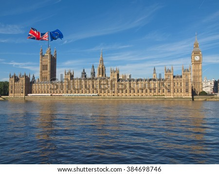 Parliament with two flags: June 23 referendum, Should the United Kingdom remain a member of the European Union or leave the European Union. The poll is aka Brexit meaning Britain exit - stock photo