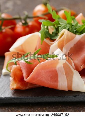 parma ham (jamon) traditional Italian meat specialties - stock photo