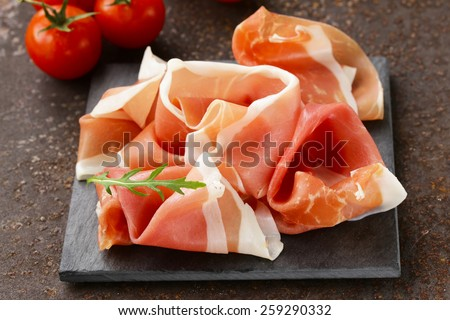 parma ham (jamon) traditional Italian meat specialties - stock photo