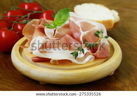 parma ham (jamon) with fragrant herbs traditional Italian meat appetizer - stock photo