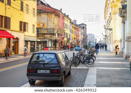 PARMA, ITALY - DECEMBER 22, 2015: Car and bicycles on old Della Repubblica street in Parma, Emilia Romagna, Italy.