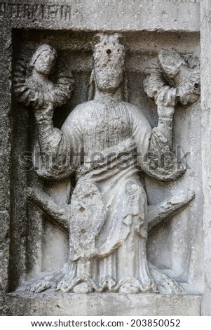 PARMA, ITALY - MAY 01, 2014: Detail of marble carvings on the baptistry from Benedetto Antelami. Baptistery in Parma is considered to be among the most important Medieval monuments in Europe.