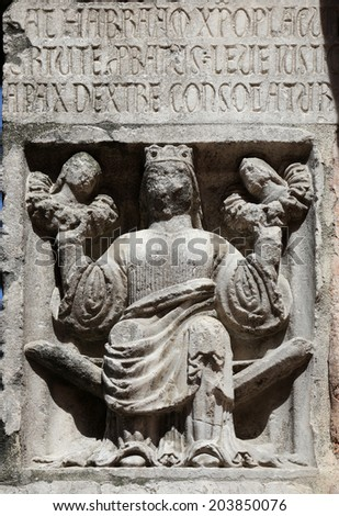 PARMA,ITALY-MAY 01, 2014:Faith(holding Justice and Peace)relief at the baptistry from Benedetto Antelami. Baptistery in Parma is considered to be among the most important Medieval monuments in Europe.