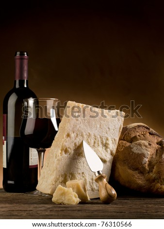 parmesan cheese bread and red wine - stock photo