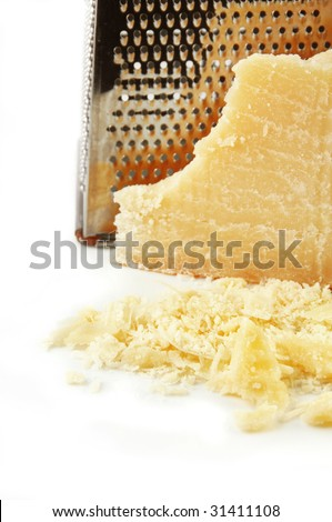 Parmesan cheese freshly grated on a white background.