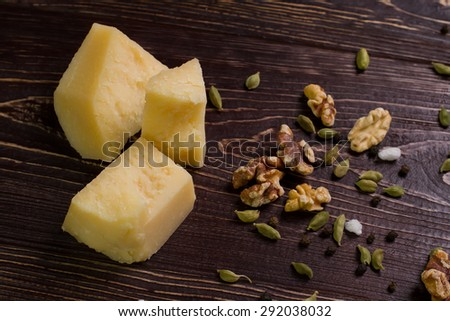 Parmesan cheese,walnuts and spices.Ingredients on a wooden table. - stock photo