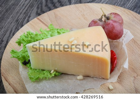 Parmesan cheese with grape and salad leaves