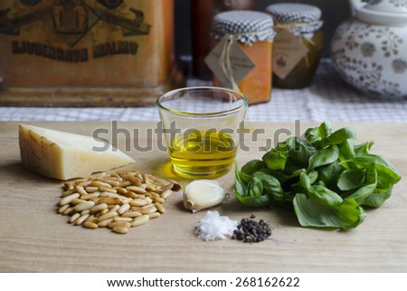 Parmesan, pine nuts, garlic, olive oil and basil - pesto - stock photo