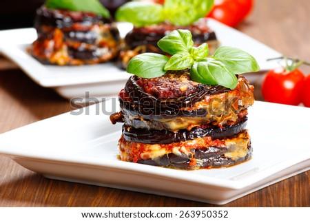 Parmigiana di melanzane: baked eggplant - italy, sicily cousine - stock photo