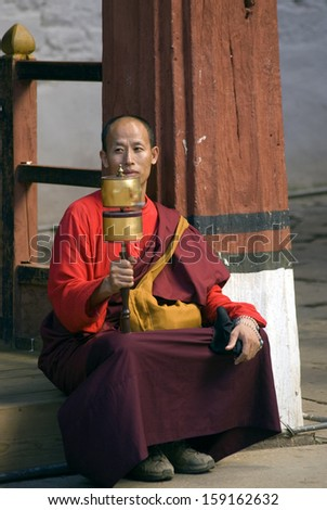 PARO, BHUTAN - SEPTEMBER 27: Monk at Paro Dzong on September 27, 2013 in Paro, Bhutan. Paro Dzong is one of the most important Buddhist site in the country, monks are living and prectising there.