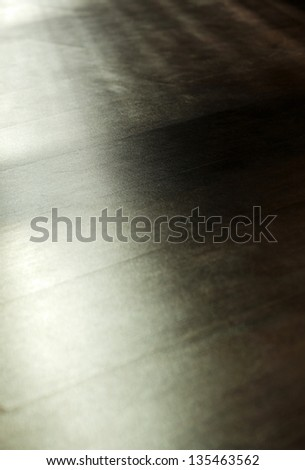 Parquet floor back lit by diffused afternoon window light. Shallow depth of field. - stock photo