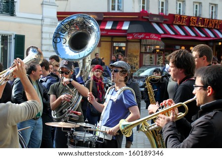PARS, FRANCE - OCT. 13: Group of young musicians as seen on Montmartre in Paris on October 13, 2013 in Paris, France. Dozens buskers perform on the streets and in metro of Paris. - stock photo