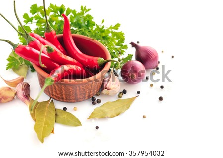 Parsley, garlic clove, onion, red pepper and spices on white background - stock photo