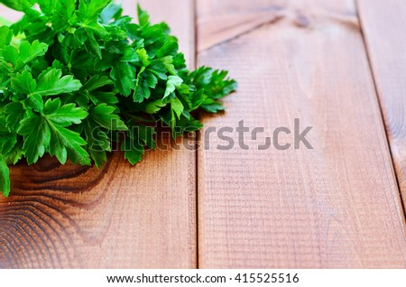 Parsley in a corner on a wooden background - stock photo
