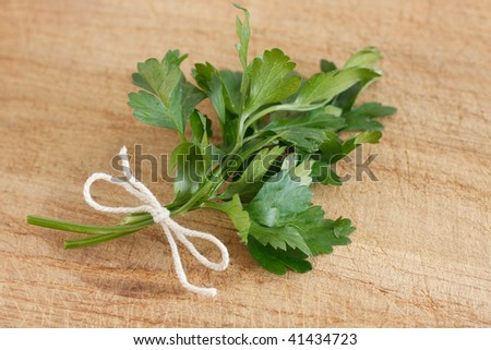 Parsley on a wooden surface