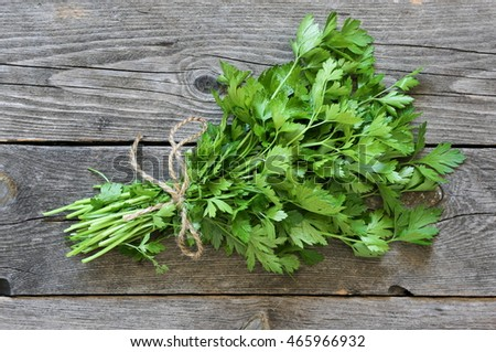 Parsley sheaf on gray old wooden table