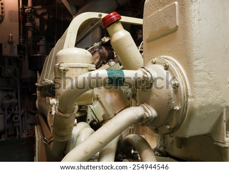 Part and pipes of old ship diesel engine - stock photo