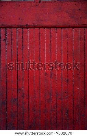 part of a battered red door - stock photo