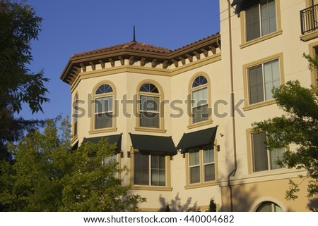 Part of a beautiful apartment house and sunset