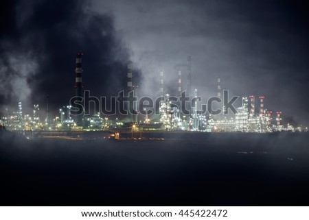 Part of a big oil refinery by night (reinfiorced the steam around the oil refinery)