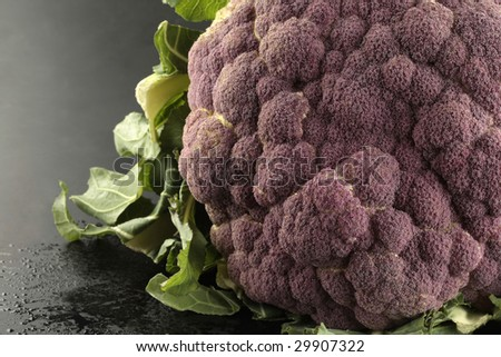 Part of a cauliflower on black background