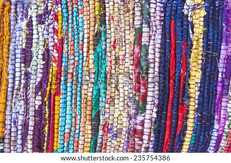Part of a colorful rug made from recycled textiles - stock photo