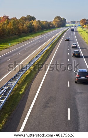 Part of a european highway with cars in motion. - stock photo