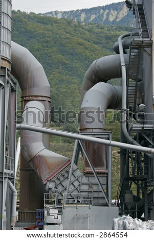part of a factory in the mountain - stock photo