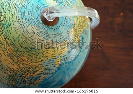Part of a globe with map of North Asia and Arctic - stock photo