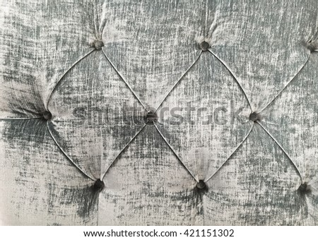 Part of a grey upholstered seat as a background  - stock photo