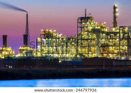 Part of a heavy Industrial Chemical area with vibrant surreal mystical colors and lights in twilight - stock photo