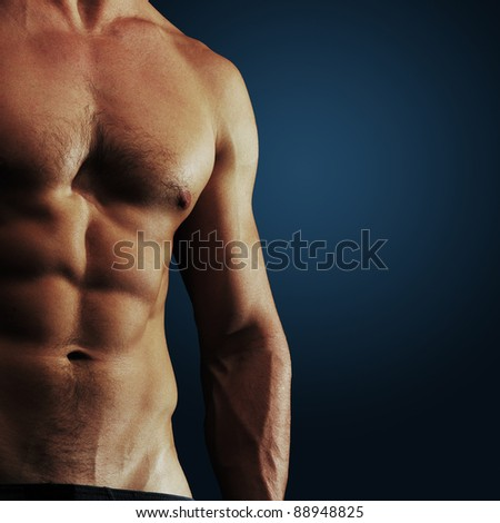 Part of a man's body on a dark blue background - stock photo