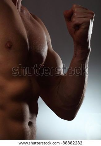 Part of a man's body on a gray background