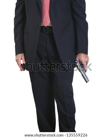 Part of a mature adult man wearing a suit and tie, standing with a gun in his left hand. Isolated on white background. - stock photo