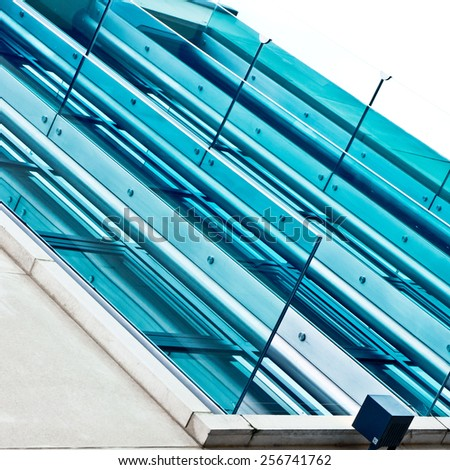 Part of a modern building with glass panels - stock photo