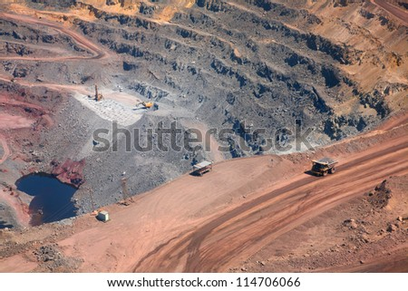 part of a pit with car - stock photo
