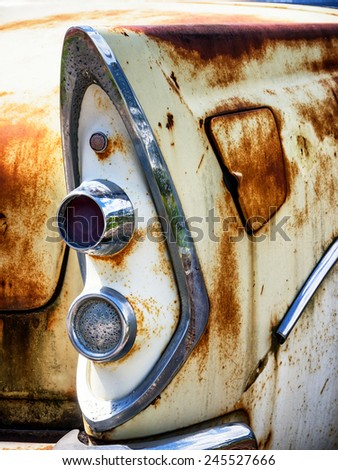part of a rusty vintage car - stock photo