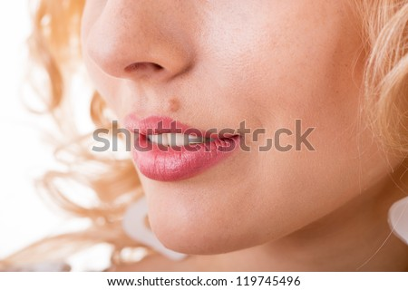 part of a woman's face with a mole close-up - stock photo