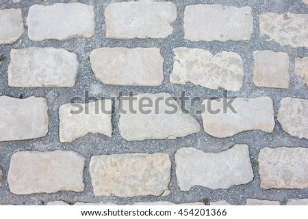 Part of aged brick wall close up - stock photo