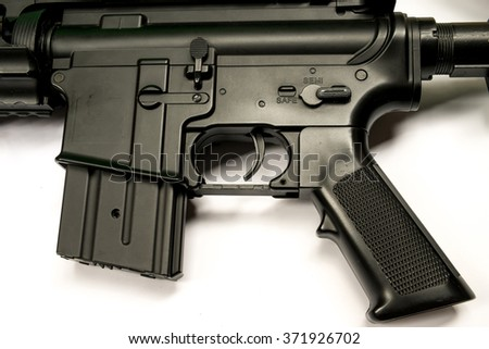 Part of air soft gun in white background - stock photo