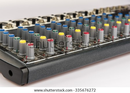 part of an audio sound mixer with buttons and sliders