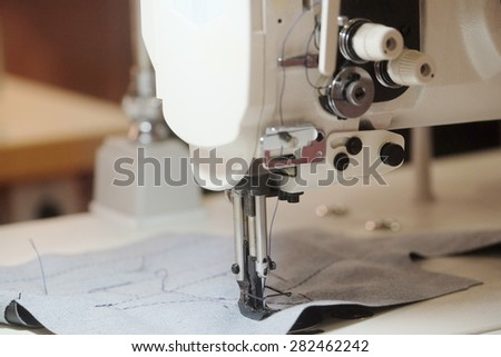 Part of an industrial sewing machine - stock photo