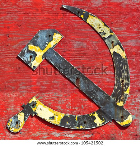 Part of an old wooden ship wreck with the cccp hammer and sickle in steel attached to it - stock photo