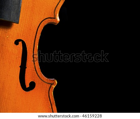 Part of antique violin isolated on black - stock photo