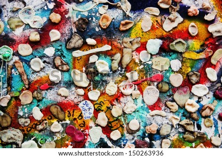 Part of Berlin Wall with graffiti and chewing gums stuck on it. Potsdamer Platz, Berlin, Germany - stock photo