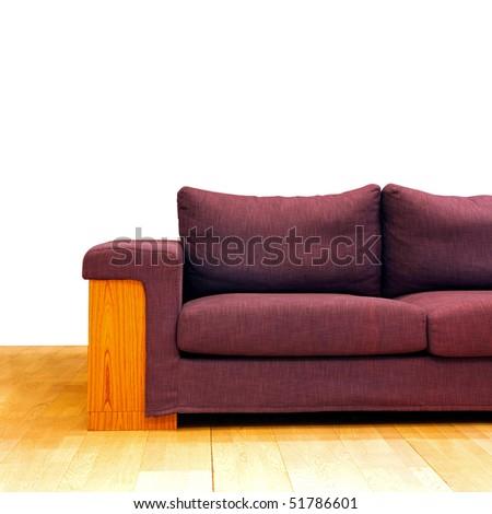 Part of big purple linen sofa furniture - stock photo