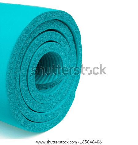 Part of blue fitness mat on white background - stock photo