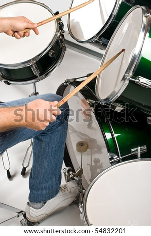 Part of body drummer playing on drum set - stock photo