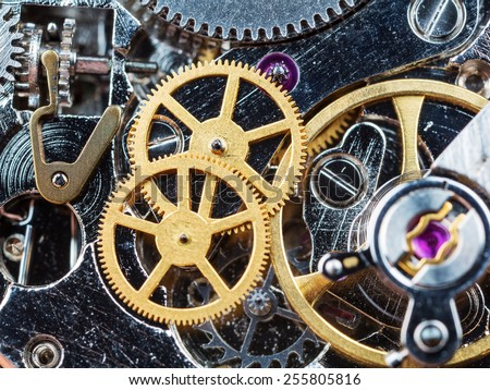 Part of clockwork with gears, spring, ruby. Steel and brass. - stock photo