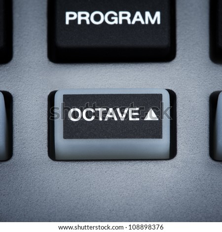 part of digital midi keyboard, octave button - stock photo